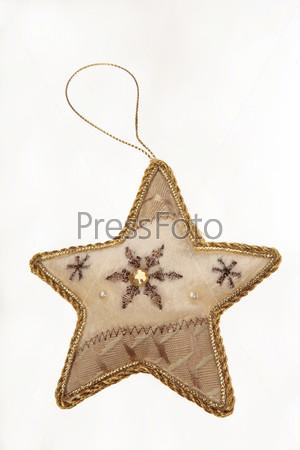 Игрушечная новогодняя звезда со снежинками