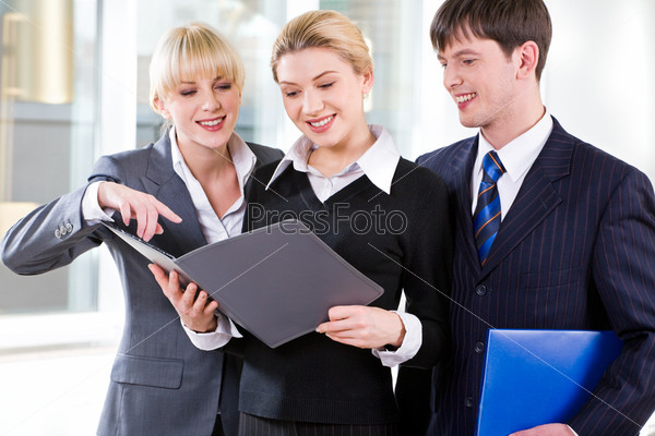 Portrait of confident people discussing a plan at business