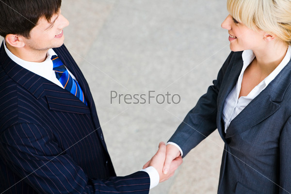 Creative image of people shaking hands making an
