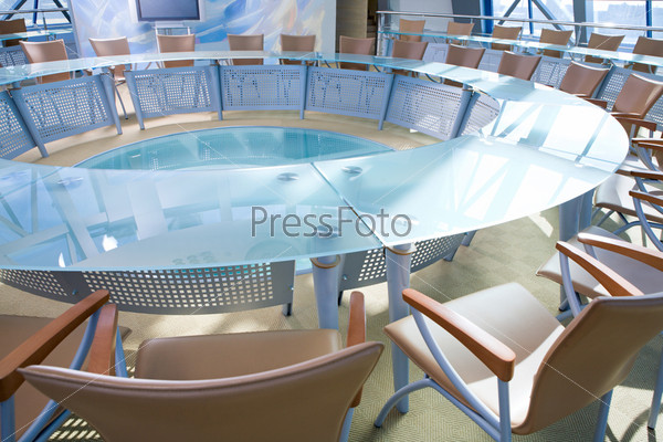 Conference room: chairs around a large glassy table