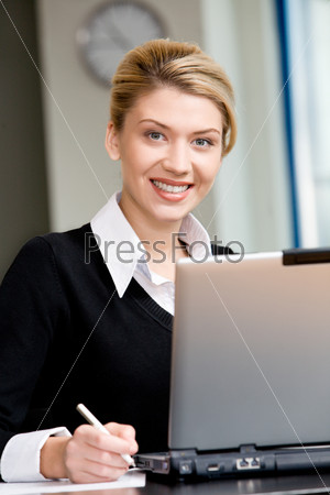 Portrait of confident business woman looking at a camera