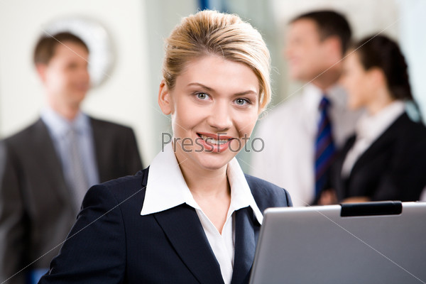 Portrait of successful specialist with wonderful smile in a office