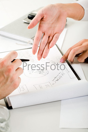 Image of business woman's hand pointing at a new project