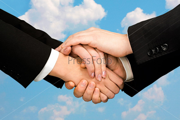Pile of human hands isolated on a sky background