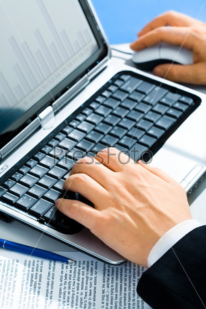 Typical image of hands typing on a laptop