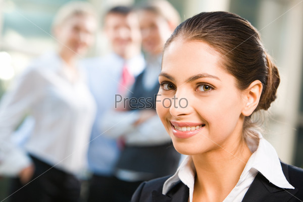 Attractive self-confident business lady with a happy smile