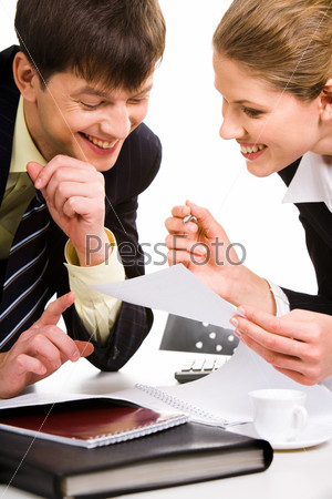 Portrait of woman and man looking at a document and  discussing it