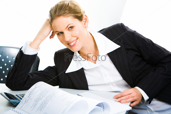 Smiling business woman leans her elbow on a table