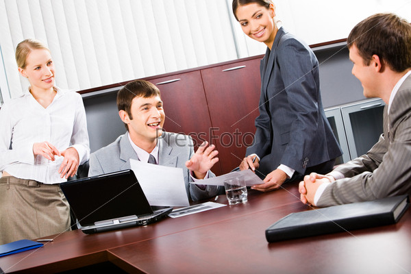 Portrait of confident business people discussing a project in a boardroom