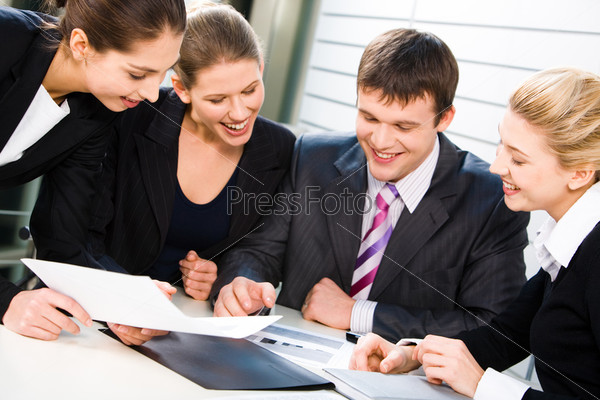 A group of business people discussing the contract and smiling happily