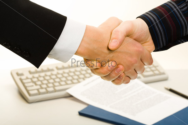 Image of business people's hands making an agreement