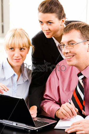 Portrait of three confident white collar offices looking at something
