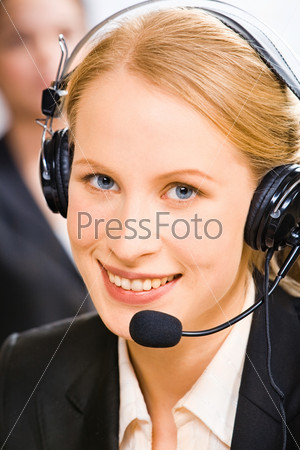Face of young smiling confident consultant with blue eyes