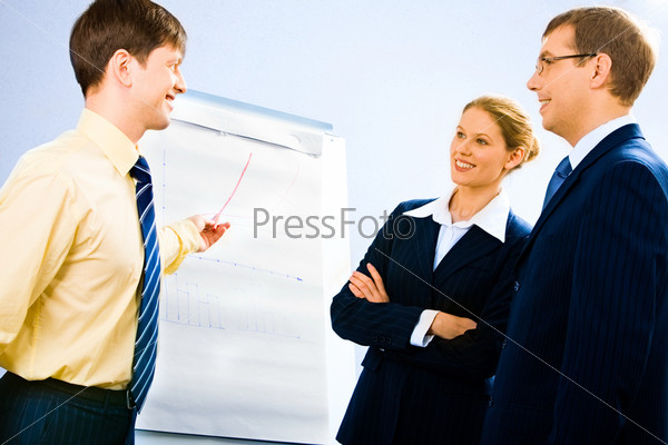 Portrait of successful businessman doing presentation on whiteboard at seminar