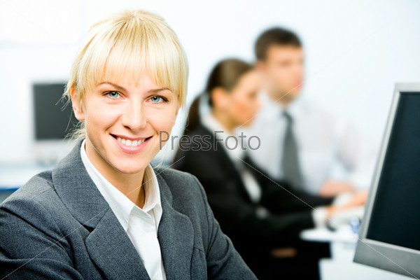 Portrait of beautiful businesswoman sitting near computer