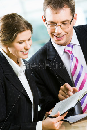 Vertical image of business partners working in the office