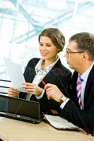 Portrait of two business people discussing a project at meeting