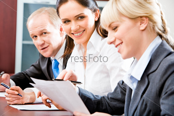 Portrait of two smiling businesswomen working with documents