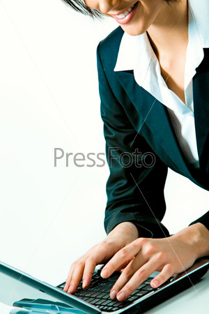 Closeup of businesswoman typing documents on the laptop