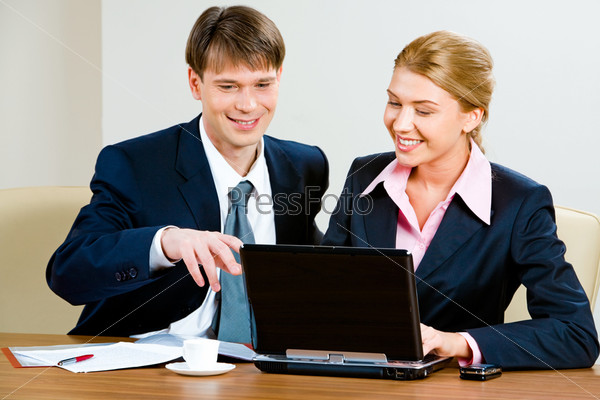 Image of confident manager discussing with colleague a project