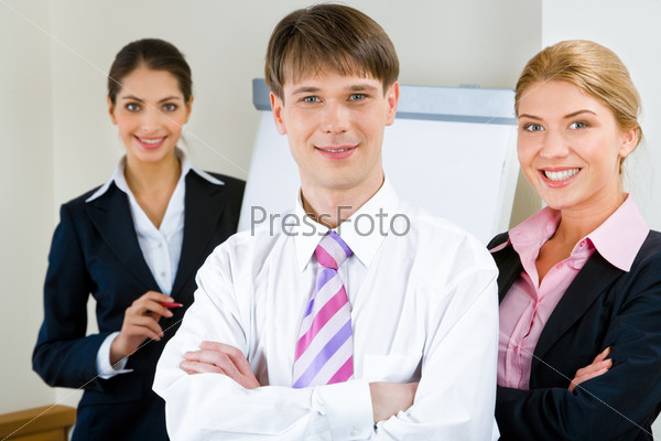 Portrait of three businesspeople looking at camera with smiles