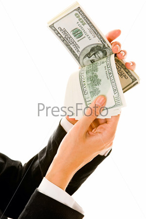 Image of businesswoman's hands holding US dollars