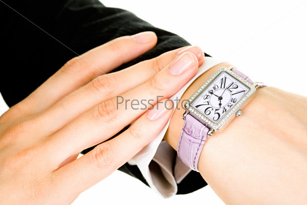 Closeup of businesslady's hand with a watch on it