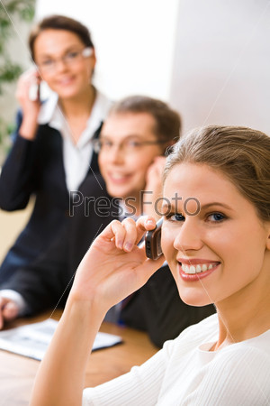 Image of attractive woman calling by mobile