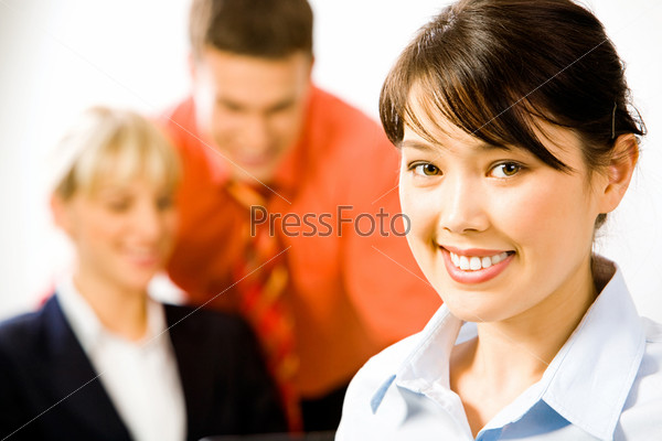 Face of the attractive business woman on the background of two people