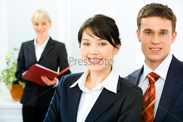 Photo of confident business people looking at camera