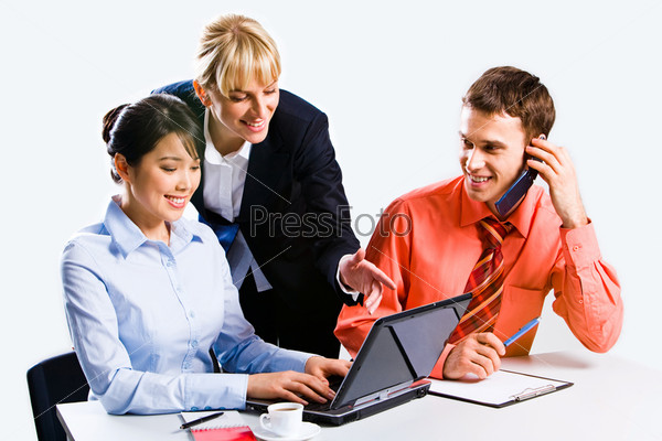 Portrait of three confident business people working