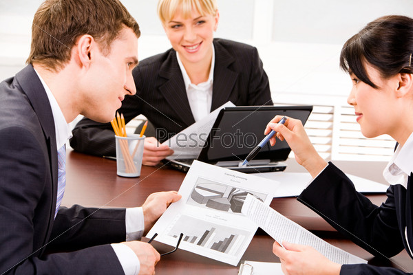 Image of business people planning a new project in a working environment