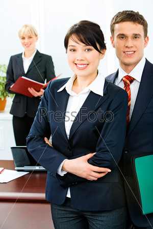 Image of successful business people standing in front
