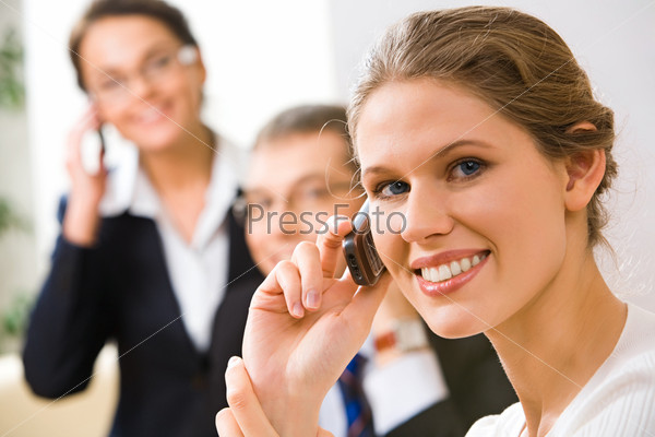 Portrait of beautiful business woman talking with people on her mobile