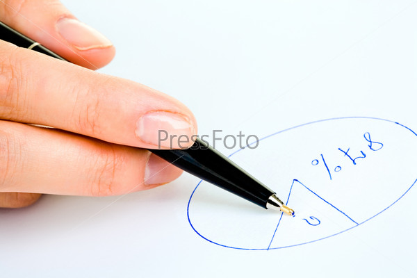 Closeup of human hand holding a pen and drawing a round diagram