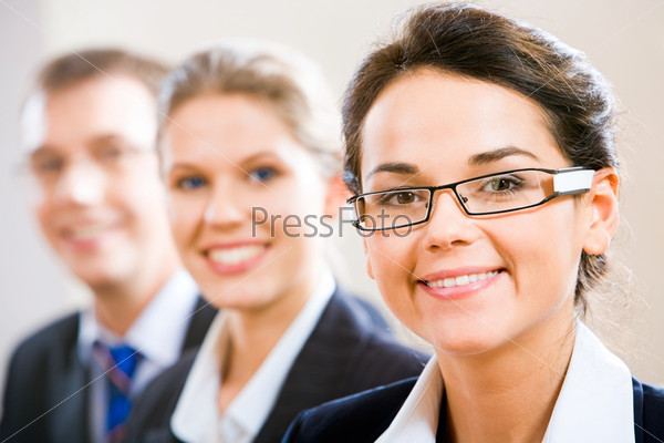 Row of business people with clever woman in front