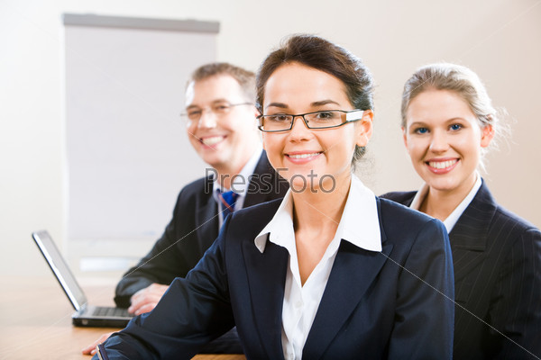Image of female leader with her business team