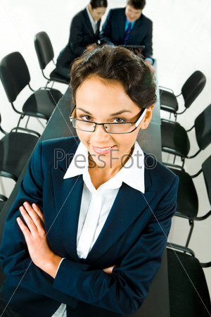 Portrait of business woman folding his arms in the office