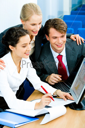 Image of business group doing some computer work
