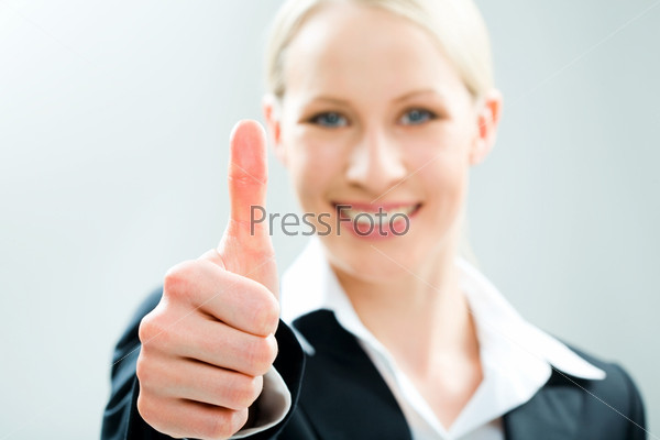 Image of business woman giving the thumbs-up sign