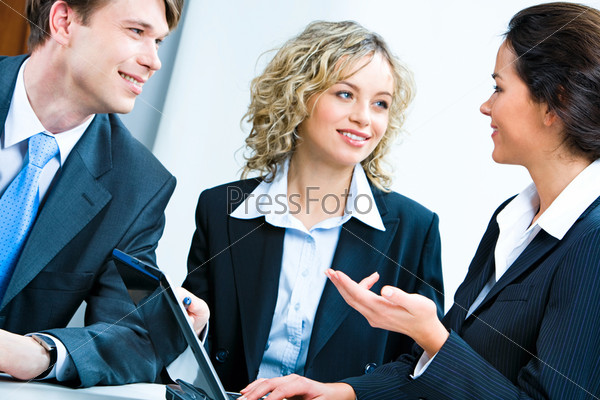 Business woman telling her plan of work to co-workers at meeting