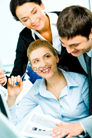 smart smiling businesswoman with document in hand looking at businessman