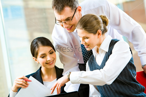 Portrait of a pretty business lady pointing at business plan