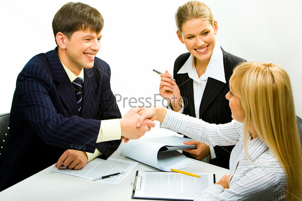 Portrait of two happy business partners shaking hands during business meeting