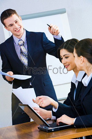 Image of successful man giving a report at business briefing