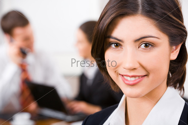 Face of confident beautiful secretary on the background of people