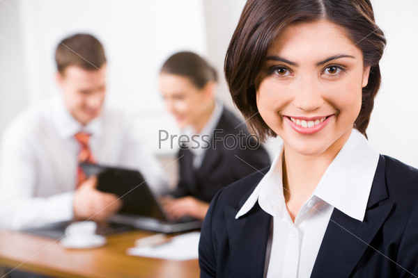 Image of attractive woman with smile on the background of business people