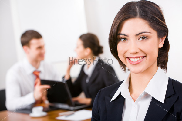 Photo of a young businesswoman's face looking at camera with smile