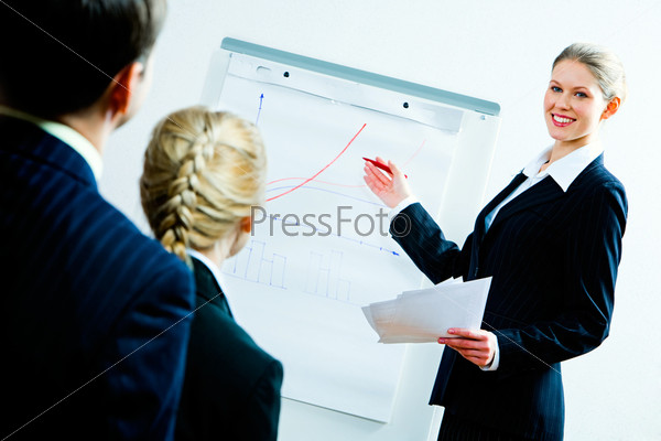 Portrait of business woman showing a plan of development to co-workers