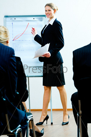Image of successful woman teaching a business lecture
